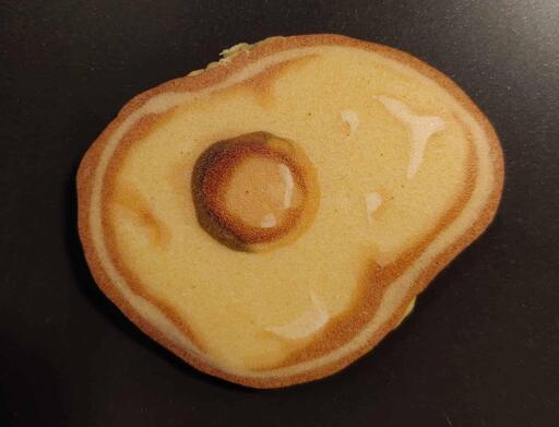 Pancake art of a fried egg.