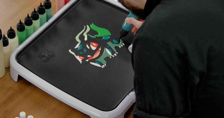Bulbasaur pancake art step 5.3: Fill in bulbasaur's spots/markings with your deeper blue/blue-green batter.