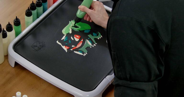 Bulbasaur pancake art step 6.1: Begin filling in the rest of bulbasaur's bulb with your middle green batter.