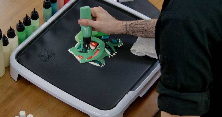 Bulbasaur pancake art step 6.2: Move on to your lighter blue-green batter and begin filling bulbasaur's body.