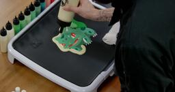 Bulbasaur pancake art step 7.1: Begin to outline your bulbasaur design with plain pancake batter.