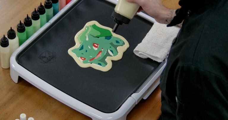 Bulbasaur pancake art step 7.2: When you complete the outline, it will lend extra body to your pancake and make the art on the other side pop.