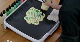 Bulbasaur pancake art step 7.3: We like to add a few zig-zags of extra batter to the back of your pancake art, to make sure no spots are missed and make the pancake a little thicker.