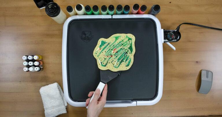 Bulbasaur pancake art step 9.1: Have confidence when you flip the pancake. Gently slide the spatula under the body of the pancake...