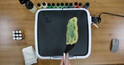 Bulbasaur pancake art step 9.2: ...turn it over smoothly...