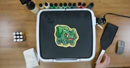 Bulbasaur pancake art step 9.3: ...And voila! The pancake is flipped. Allow it to cook for a little while on the back side, and then remember to turn off your griddle.