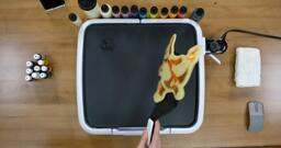 Charmander Pancake Art step 10.2: ...turn the pancake over all at once...