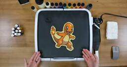 Charmander Pancake Art step 10.3: ...And reveal your pokemon pancake masterpiece! Let this charming Charmander cook on its other side for a moment, then remember to turn off your griddle.