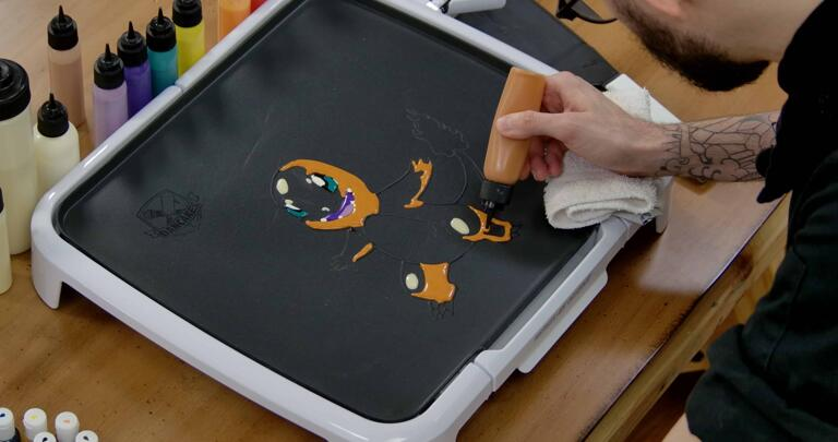 Charmander Pancake Art step 5.2: Continue to fill shading on the sides of Charmander's arms, legs and tail.
