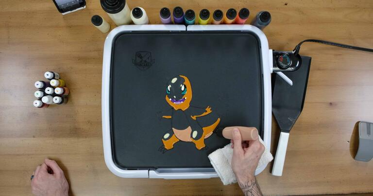 Charmander Pancake Art step 5.3: For Charmander's belly and the underside of the tail, switch to your tan/light brown batter, to create contrast between Charmander's body and underside.