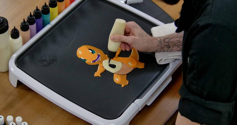 Charmander Pancake Art step 6.3: Using your plain batter, fill Charmander's belly and any area on the tail underside you missed.