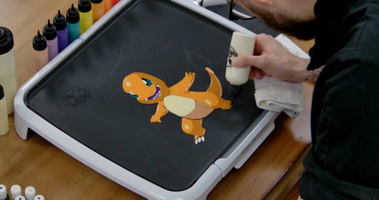 Charmander Pancake Art step 7.1: Time to fill in some final details. Using your white batter, color in Charmander's claws.