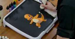 Charmander Pancake Art step 7.2: Using the white batter you have in hand, go ahead and fill in a bright core for Charmander's tail flame.