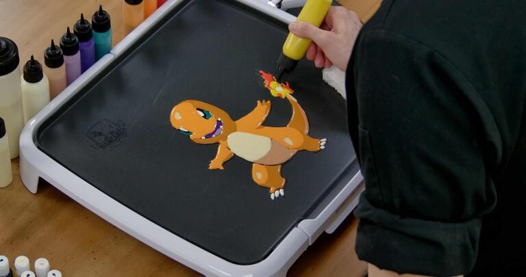 Charmander Pancake Art step 7.3: With a mix of red, orange, and yellow batters (you can have fun with this part) fill in the rest of Charmander's tail flame!