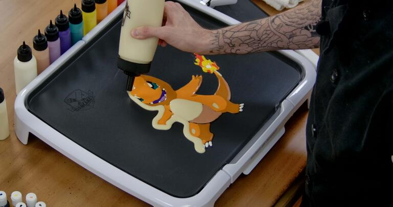 Charmander Pancake Art step 8.1: Begin outlining your pancake with plain batter - this will give it more body and hold some of the flimsy pieces (like Charmander's tail) together when it's time to flip.