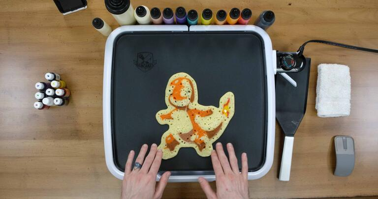 Charmander Pancake Art step 9.2: You want the whole back of the pancake to have popped bubbles, and for the surface to look like it isn't shiny anymore.
