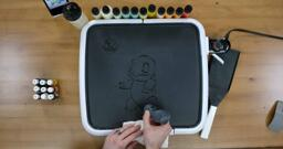 Squirtle Pancake Art step 1.2: Continue outlining Squirtle's body, belly, and shell.