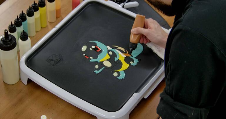 Squirtle Pancake Art step 4.3: Using your burnt orange/brown batter, shade the bottom of Squirtle's shell.