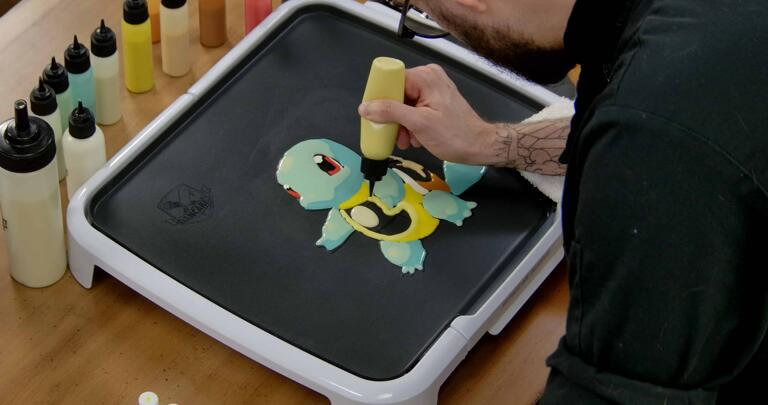 Squirtle Pancake Art step 5.2: With the lighter yellow batter, fill Squirtle's chest.