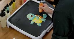 Squirtle Pancake Art step 5.3: Finally, fill in the rest of Squirtle's shell with your bold orange batter.