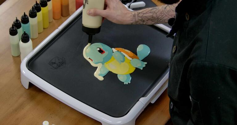 Squirtle Pancake Art step 6.1: Once a pancake design is all filled in, I like to add an outline of plain batter to give it some extra body and make it easier to flip without damaging the piece.