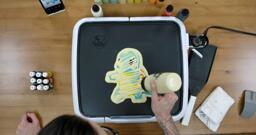 Squirtle Pancake Art step 6.3: At the very end of this step, I like to drizzle some extra batter across the back of the pancake to make sure I didn't miss any spaces.