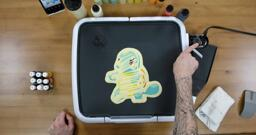 Squirtle Pancake Art step 7.1: Once your pancake design is all finished, you can turn your griddle n to about 225 degrees fahrenheit. Don't burn yourself! The surface with get hot soon, so be careful.
