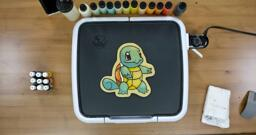 Squirtle Pancake Art step 8.3: ...And voila! You've flipped your Squirtle pancake! Look at how cute that is. Allow your design to cook on the reverse side for a moment, and then remember to turn your griddle off.