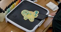Squirtle Pancake Art step 8.1: When the pancake is loose, it's time to flip! With confidence, gently slide your spatula beneath the design...