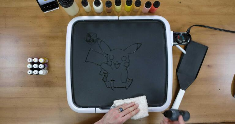Pikachu Pancake Art step 1.3: Keep outlining Pikachu's feet, back, and that iconic zig-zag tail! Your outlines don't have to be perfect, you'll get better with practice, and remember: Mistakes are Delicious!