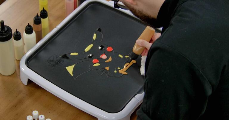 Pikachu Pancake Art step 5.2: ...spots under Pikachu's arms and feet, and on the bottom of the body...