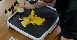Pikachu Pancake Art step 7.1: Once your pancake design is filled in, I like to add a solid outline of plain batter all around the edges. This makes the pancake stronger, makes the design pop, and gives you a little extra to snack on!