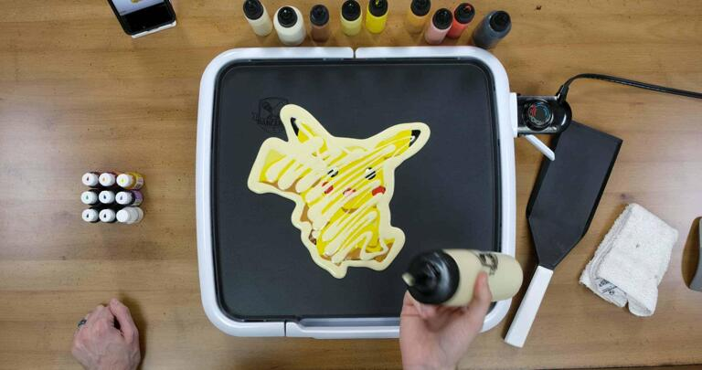 Pikachu Pancake Art step 7.3: Lastly, I like to zig-zag some plain batter across the back of my pancake designs. This adds a little bit more body to the pancake and, again, gives me more to eat!