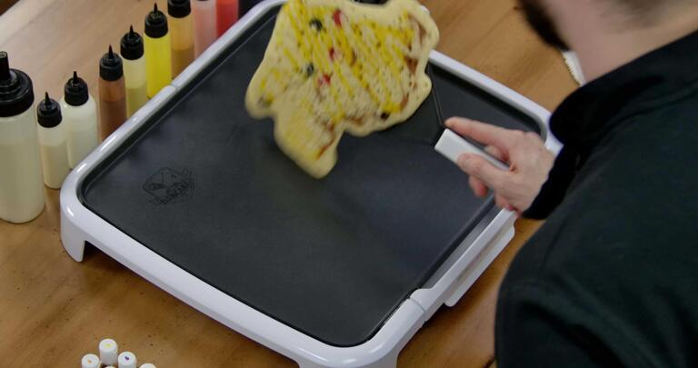 Pikachu Pancake Art step 9.2: ...turn it over gently and all at once...
