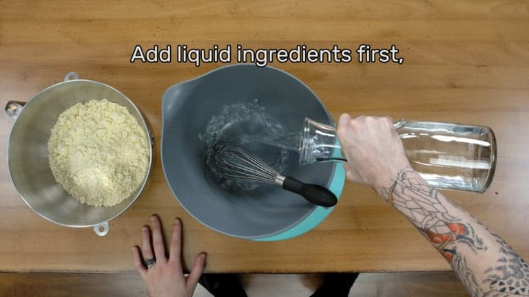 "This image shows the water being added to a mixing bowl first, and says ""Add liquid ingredients first."""