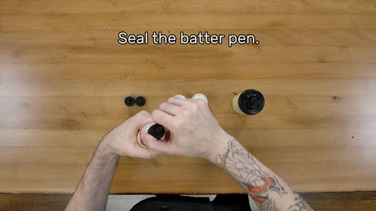 "An image of the artist sealing the batter pen by screwing the tip and cap into place firmly. The image reads ""Seal the batter pen."""