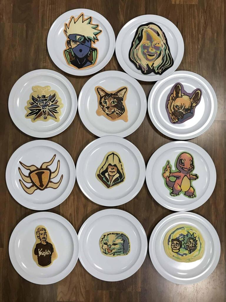 An image showing a collection of pancakes on white plates, all drawn during Dancakes' sunday request livestream!