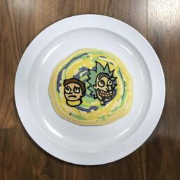 An image of a pancake drawn in the shape of Rick and Morty from the cartoon Rick and Morty, suspended within a green and yellow portal.