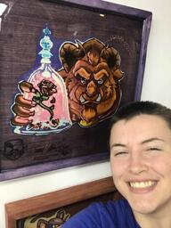 Dana smiling with Preserved Pancake Art of The Beast