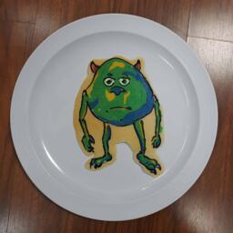 Pancake art of Mike Wazowski With Two Eyes Meme.