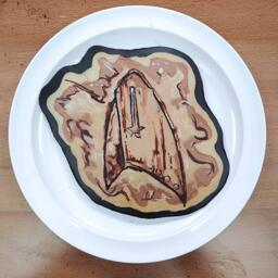 Pancake Art of a communicator badge from the TV show Star Trek Discovery